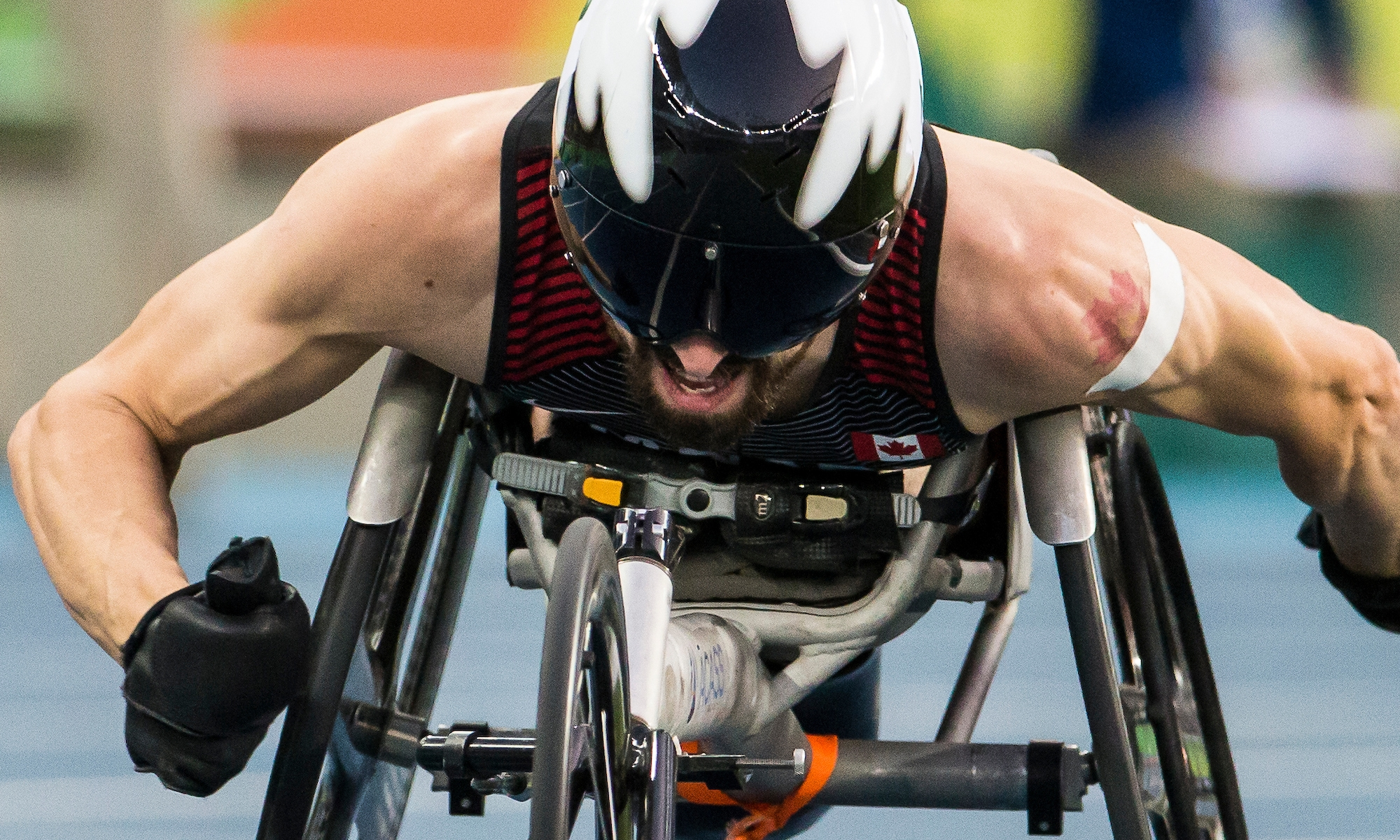 Brent Lakatos in a racing chair