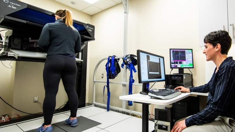 An athlete is tested on the KINARM robotic technology testing brain function.