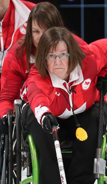 Marie Wright pushing the rock in wheelchair curling
